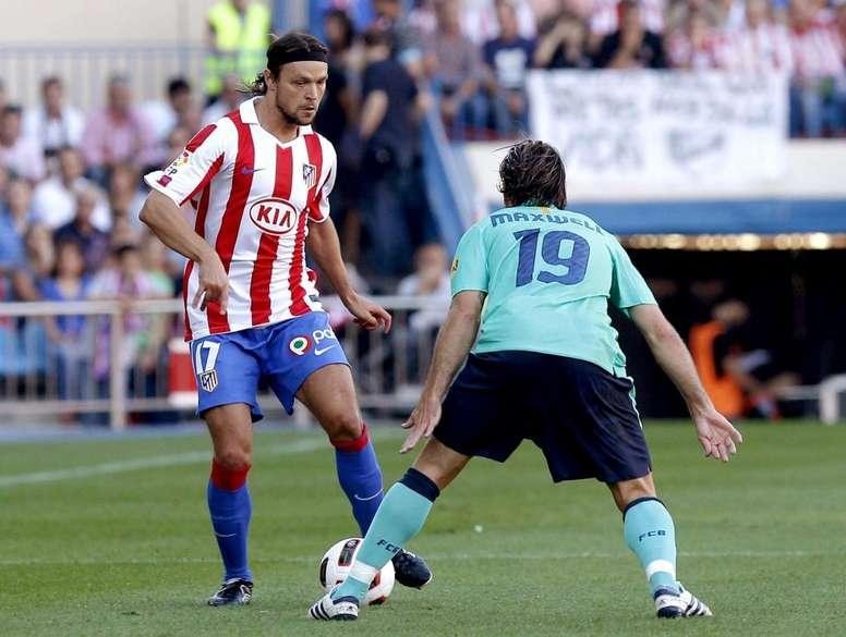 Ujfalusi sigue cargando con las consecuencias de haber lesionado a Messi. EFE/Archvo