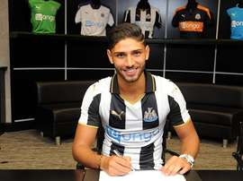 Lazaar signs his contract with Newcastle. NUFC
