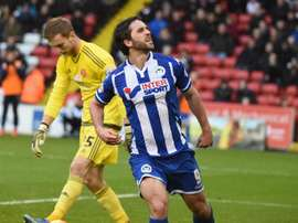 Grigg celebrates scoring for Wigan Athletic. WiganLatics
