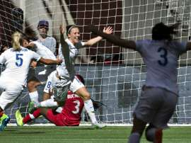 England Lucy Bronze (C) celebrates her goal against Canada with teammate Steph Houghton and Claire Rafferty (R) during the match at the 2015 FIFA Women World Cup in Vancouver on June 27, 2015