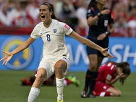 England midfielder Jill Scott celebrates as Canada defender Allysha Chapman (R) reacts to their loss during a quarterfinal football match at the 2015 Women World Cup in Vancouver on June 27, 2015