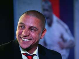 Formar Brazilian football player and team manager of Delhi Dynamos Roberto Carlos talks during a press confrence in the Indian capital New Delhi on July 9, 2015