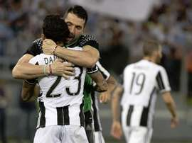 Buffon and Alves celebrating a win in their Juventus days. EFE