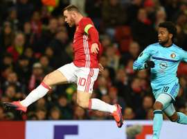Wayne Rooney kicking the ball during an Europa League match. Goal