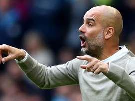 Guardiola a confirmé qu'il restera à City la saison prochaine. Goal