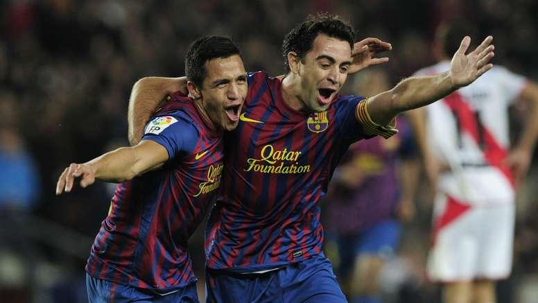 Alexis Sanchez (L) celebrates with Xavi (R) while at Barcelona. Goal
