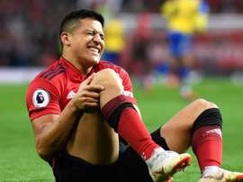 Alexis Sanchez hobbled off against Southampton. GOAL