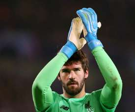 Alisson 'honoured' to write his name in football history after winning Yachine Trophy. AFP