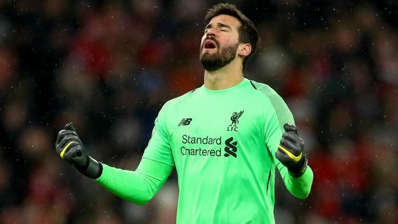 Liverpool blow as Alisson goes off injured in opening Premier League game. GOAL