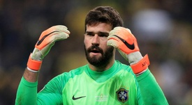Alisson played a key part as Brazil beat Paraguay on penalties. GOAL