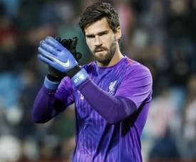 Alisson is vying for position. GOAL