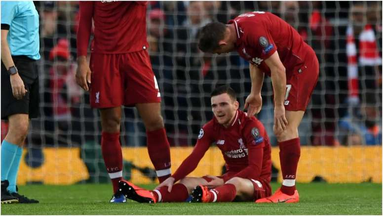 Andrew Robertson went down injured in the first half