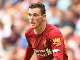Robertson sits out Liverpool game but will still face Atletico. GOAL
