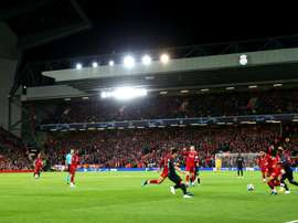 Liverpool charged by UEFA over Anfield pitch invasions. GOAL