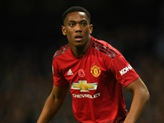 Martial was injured just before half-time in the defeat to PSG. GOAL