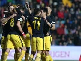 Atletico players celebrate a goal against Guijuelo. Goal