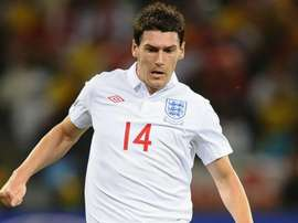 Former England international Barry retires at 39