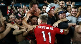 Brendon Santalab celebrating with fans of the Wanderers. Goal