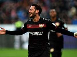 Hakan Calhanoglu celebrating a goal with Leverkusen. Goal
