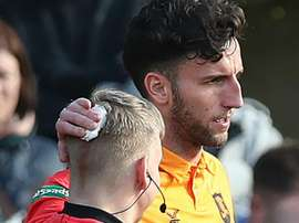 Spence received treatment on the touchline for a minor head wound. GOAL