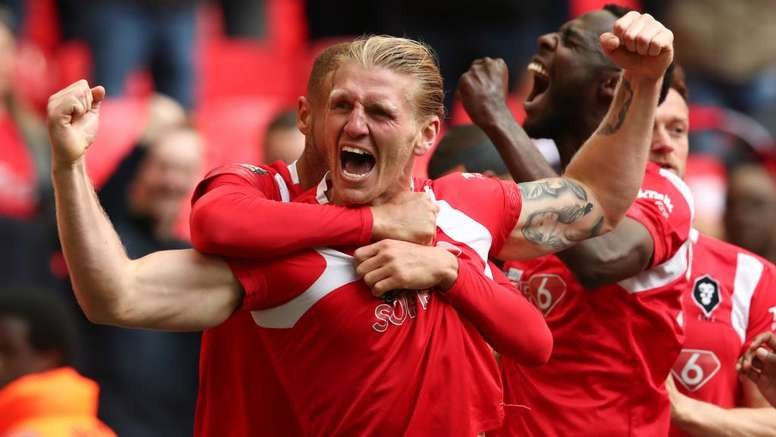 Salford City promoted to Football League for first time. Goal