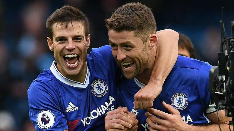 Cahill (R) wants Chelsea to record 12 wins in a row. Goal