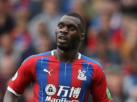Benteke, Tomkins renew Palace deals. GOAL