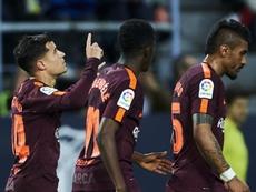 Coutinho celebrou um belo gol diante do Málaga. GOAL