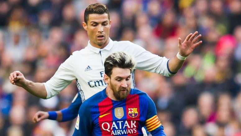 Cristiano Ronaldo challenges Lionel Messi in El Clasico. Goal