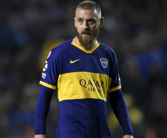 De Rossi celebrates winning league bow for Boca Juniors