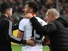 Abraham charges over Freiburg coach