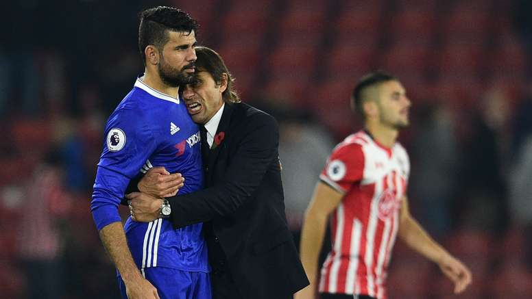 Diego Costa and Antonio Conte hugging. Goal