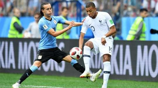 Diego Laxalt Kylian Mbappe Uruguay France World Cup. Goal