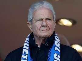 Dietmar Hopp tells 'idiot' fans: I won't stop coming to Hoffenheim games. AFP