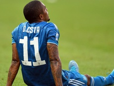 Douglas Costa will miss the trip to Madrid to face Atletico. GOAL