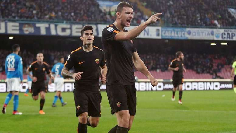 Dzeko scored twice as Roma came from behind to beat Napoli. AFP