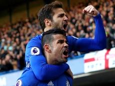 Fabregas and Costa celebrating a goal. Goal