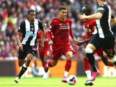 Van Dijk was full of praise for Firmino after Liverpool's win over Newcastle. GOAL
