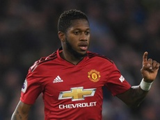 Fred hit by object during Manchester derby and seemingly subjected to racist abuse. GOAL