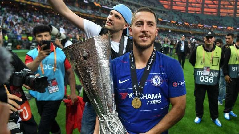 Eden Hazard with the Europa League trophy. GOAL