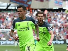 Lallana et Coutinho lors d'un match de Premier League avec Liverpool. AFP