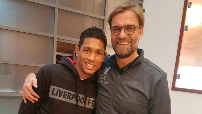 Jurgen Klopp and Wayde van Niekerk. Goal