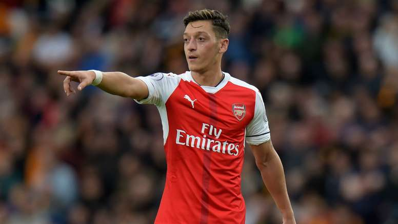 Mesut Ozil has come in for criticism by Birtish media. AFP