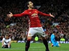 Mkhitaryan celebrates his goal against Tottenham Hotspur. Goal