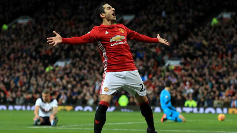 Mkhitaryan celebrates his goal against Tottenham Hotspur. Goal