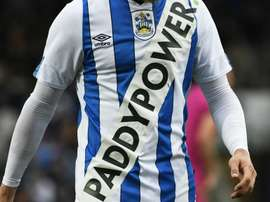 Huddersfield Town charged with misconduct following fake kit stunt. GOAL