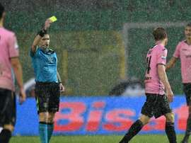 The referee showing the yellow card during the game between Inter and Palermo. Goal