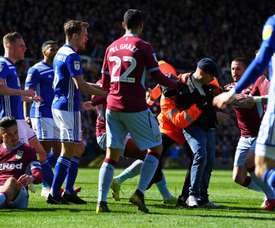 Grealish was punched by a pitch invader. GOAL