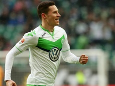 Julian Draxler celebrates scoring for Wolfsburg. Goal