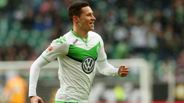 Julian Draxler celebrates scoring for Wolfsburg. Goal